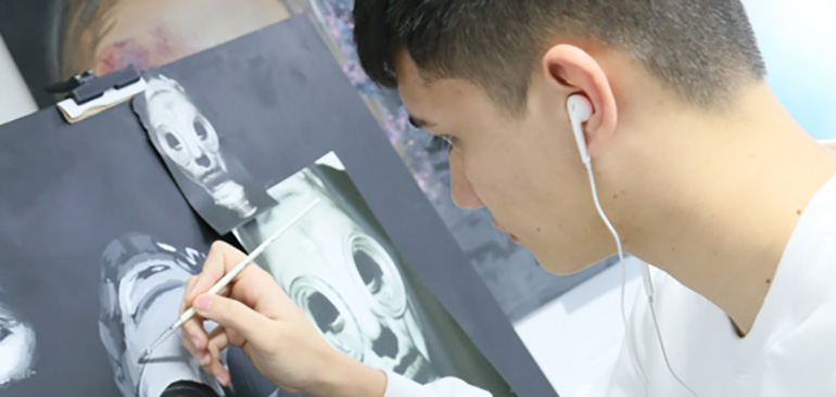 A Fine Art Student working on a drawing