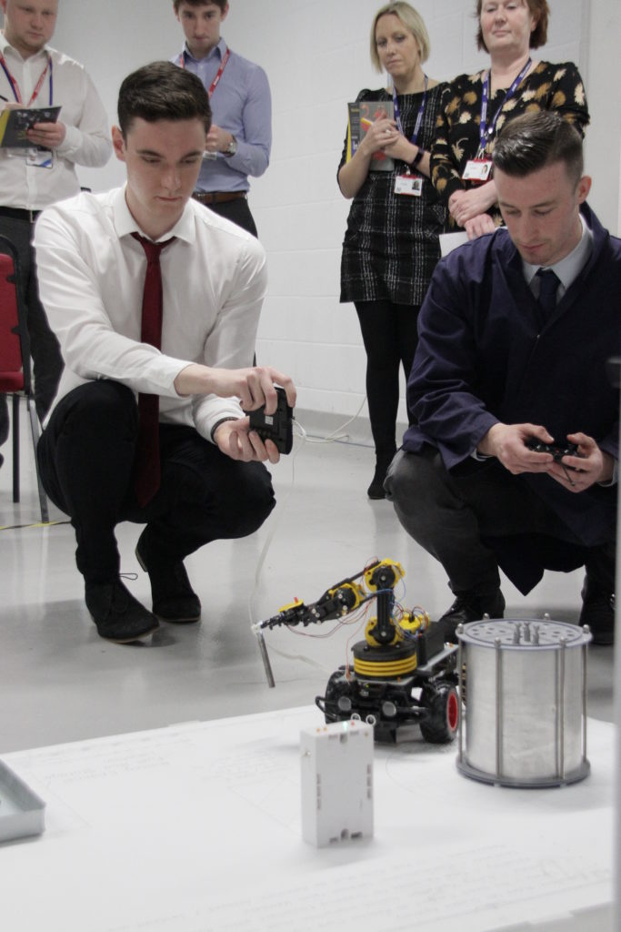 Science and Engineering Students test out a robot