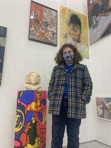 Max Kenny next to his sculpture