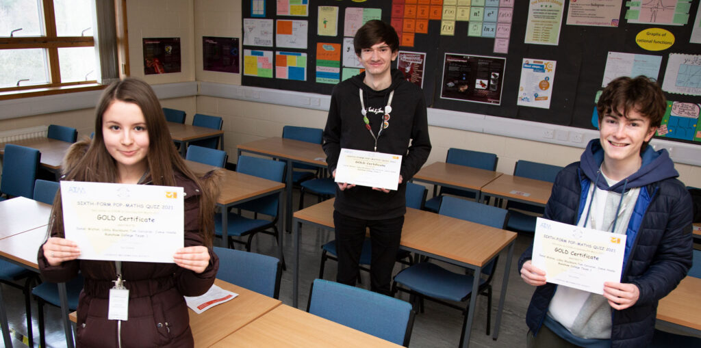The Runshaw Maths winners holding their certificates